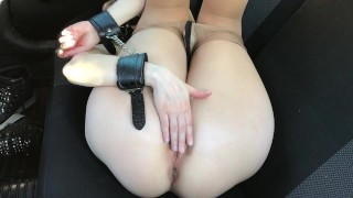 Bdsm slave, handcuffs, gag, clothespins on nipples